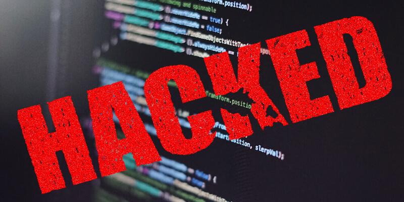 """Das Wort """"Hacked"""" über das Bild eines Bildschirms gelegt"""
